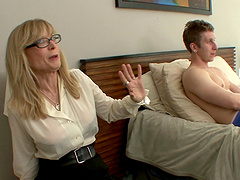Nina Hartley wearing a skirt and stockings and getting pounded