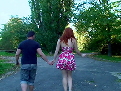 Stunning redhead Barbara Babeurre plays with a big cock outdoors