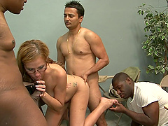 A White girl in glasses gets fucked hard by three guys